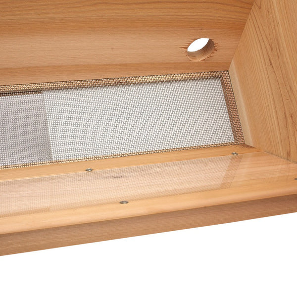 Looking down into hive showing screened bottom and insert