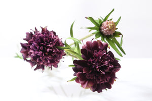 Artificial purple scabious with two dainty flowers and a small