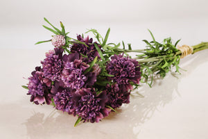 Bunch of silk purple scabious with two dainty flowers and a small bud