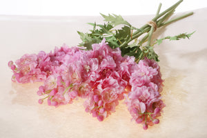 Artificial pink double delphinium
