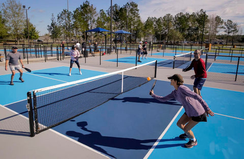 """<img src=""""pickleball.png"""" alt=""""mixed doubles pickleball rally"""">"""