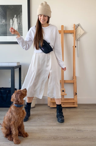 Casual white slip dress outfit image pairs slipdress with dog, sweatshirt, and lug sole boots.