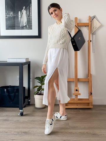 Cute slip dress outfit. Cable knit sweater, patent bag, silk hair scarf, and white sneakers