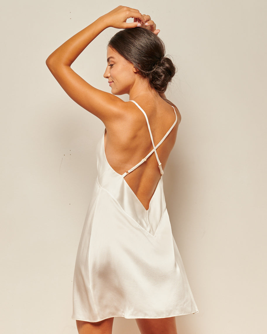 backless white silk slip dress