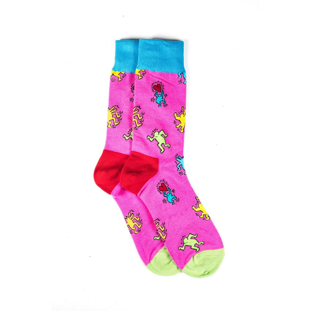 Funky novelty colourful socks for men and women in pink dancing people, vertical flat lay showing length