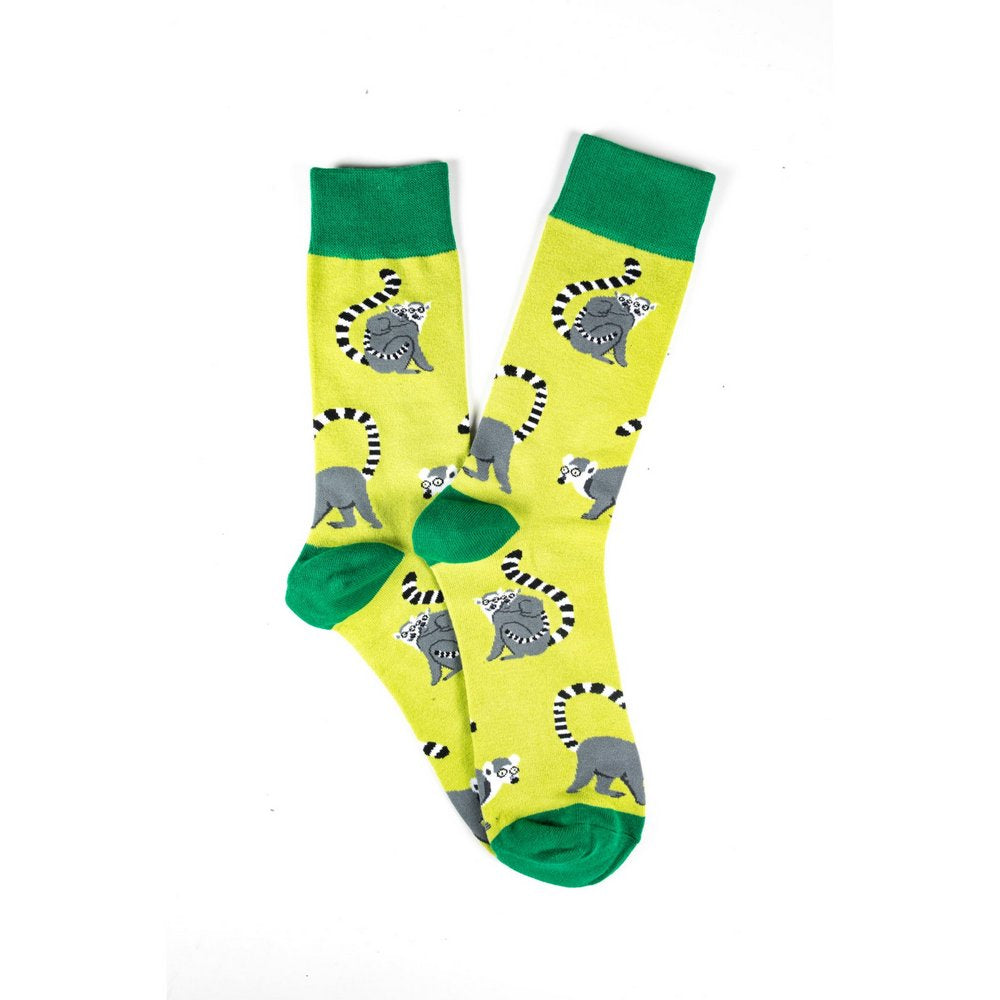 Funky novelty colourful socks for men and women in yellow lemur print, fanned flat lay showing print