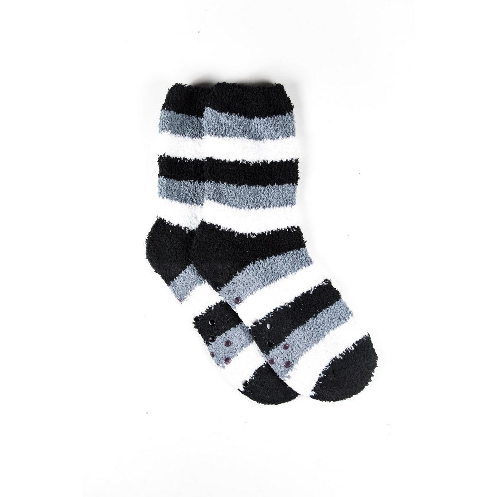 Cosy bed socks for women with non-slip bottoms in black grey stripes, flat lay showing length