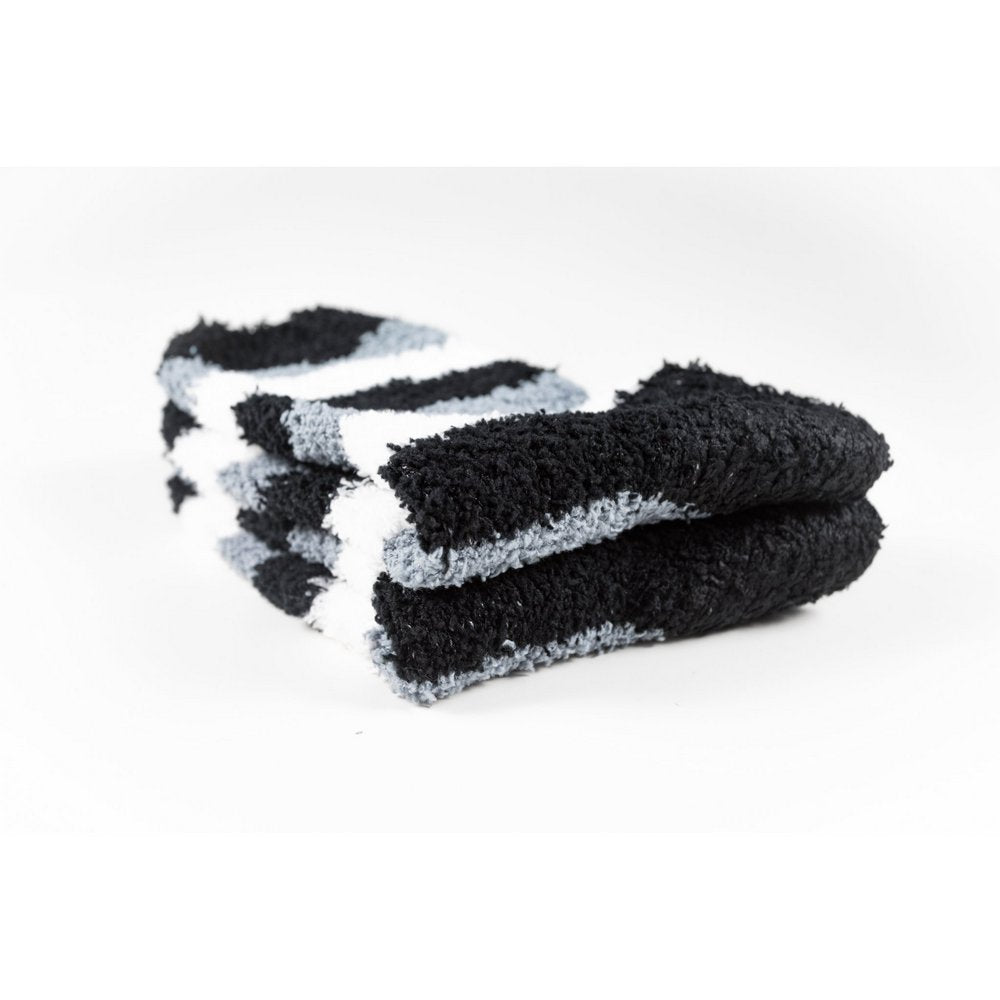 Cosy bed socks for women with non-slip bottoms in black grey stripes, close up of thickness