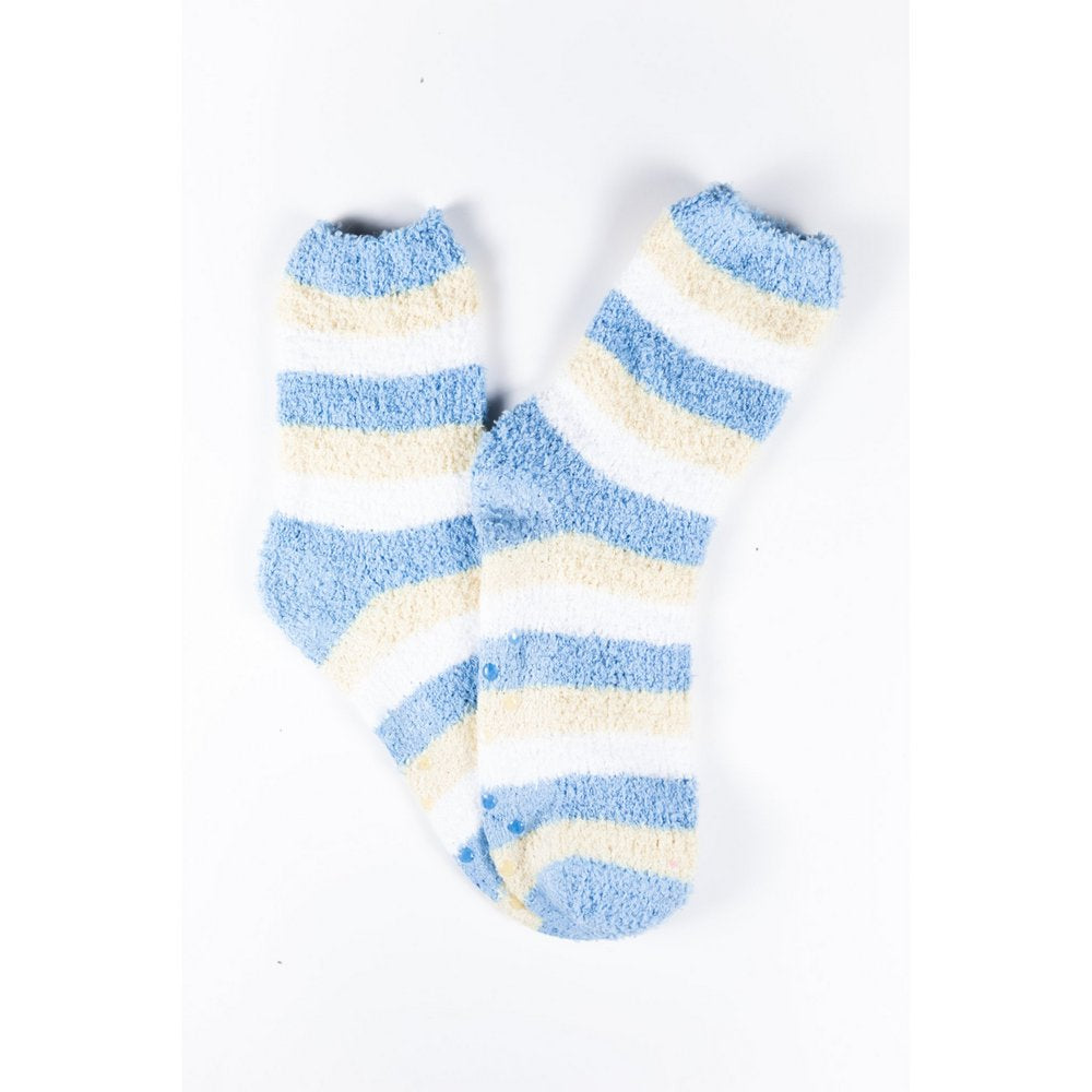 Cosy bed socks for women with non-slip bottoms in baby blue yellow stripes, flat lay showing pattern