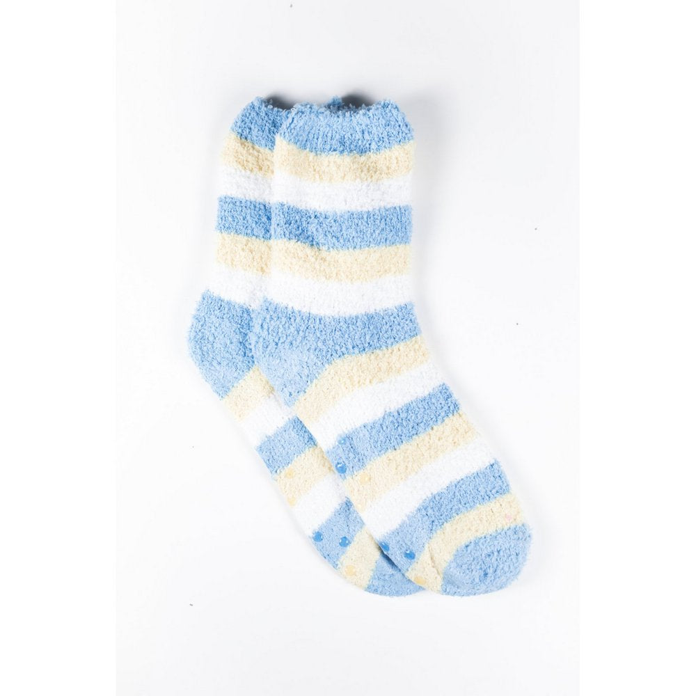 Cosy bed socks for women with non-slip bottoms in baby blue yellow stripes, flat lay showing crew length
