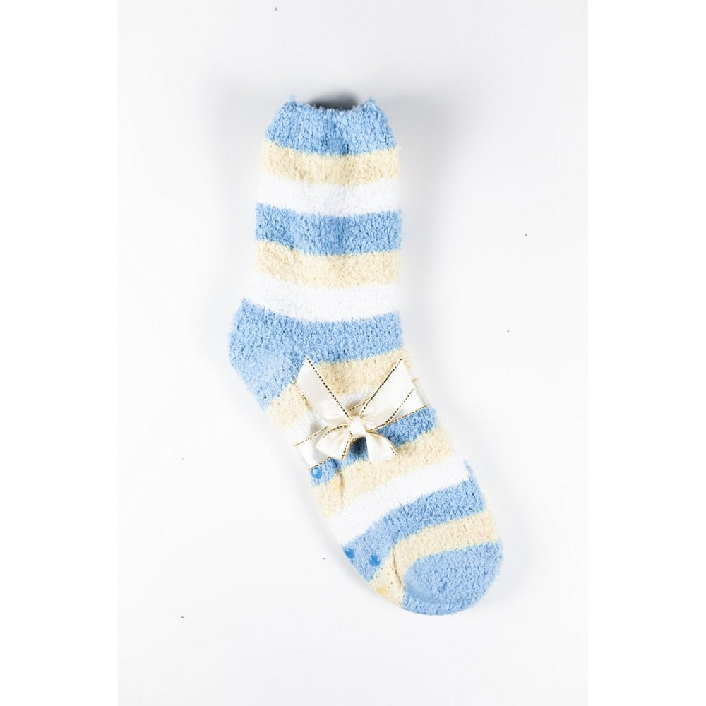Cosy bed socks for women with non-slip bottoms in baby blue yellow stripes, flat lay showing gift packaging with ribbon