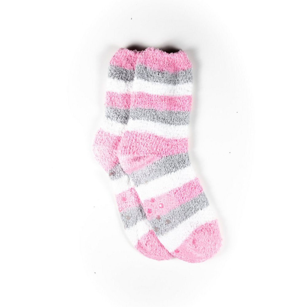 Cosy bed socks for women with non-slip bottoms in baby pink grey stripes, flat lay showing crew length