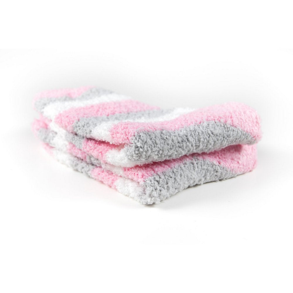Cosy bed socks for women with non-slip bottoms in baby pink grey stripes, close up showing thickness