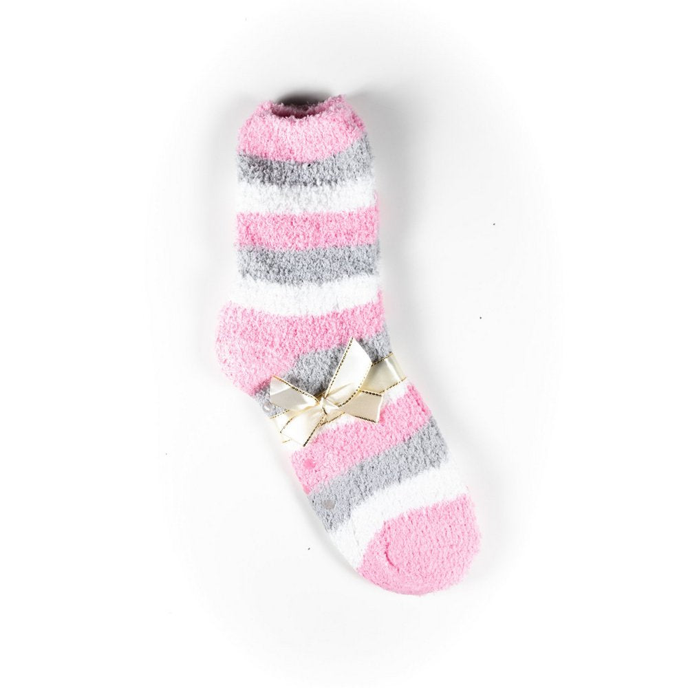Cosy bed socks for women with non-slip bottoms in baby pink grey stripes, flat lay showing gift packaging with ribbon