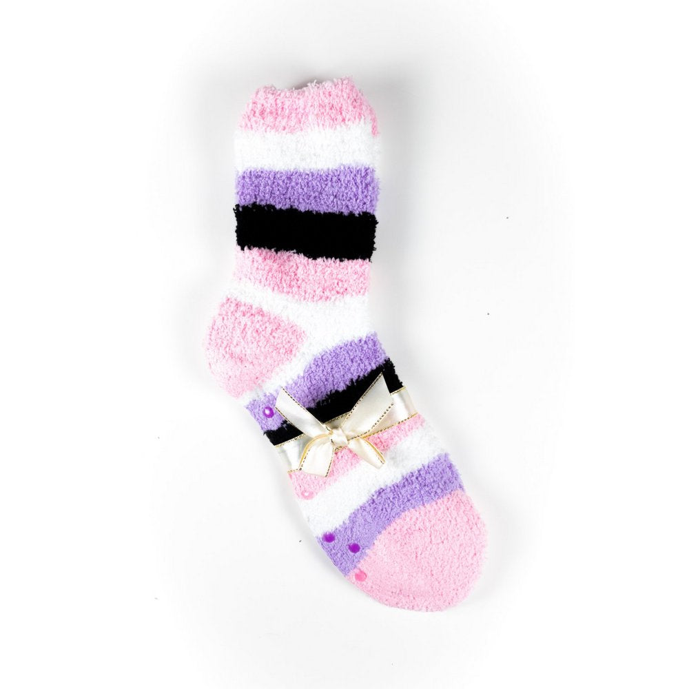 Cosy bed socks for women with non-slip bottoms in pink purple black stripes, flat lay showing gift packaging