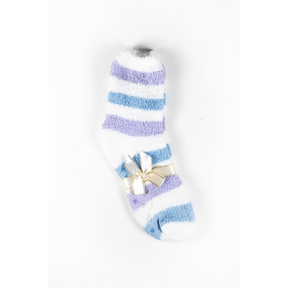 Cosy bed socks for women with non-slip bottoms in blue grey stripes, flat lay showing gift packaging with ribbon