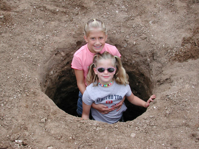 My daughters thought the pier hole was a fun place to play