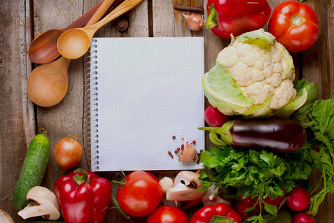 Healthy food and a note pad on kitchen counter