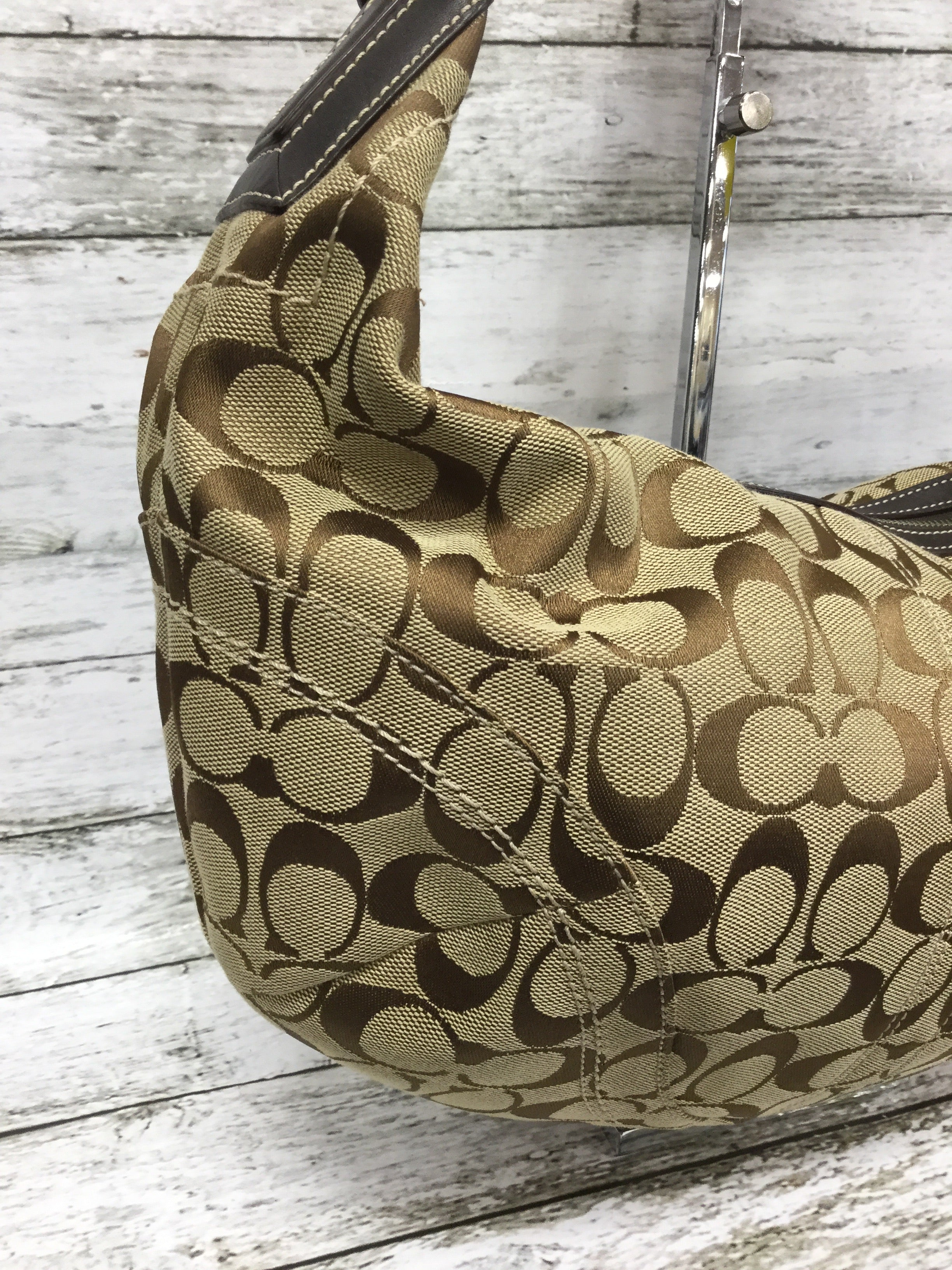 "Photo #2 - BRAND: COACH , STYLE: HANDBAG DESIGNER , COLOR: TAN , SIZE: MEDIUM , OTHER INFO: CLOTH MATERIAL , SKU: 127-4169-34834, , THIS CLOTH COACH HANDBAG FEATURES THE CLASSIC COACH ""C"" DESIGN. IT HAS AN ADJUSTABLE LEATHER SHOULDER STRAP. IT IS VERY CLEAN WITH VERY LITTLE WEAR."