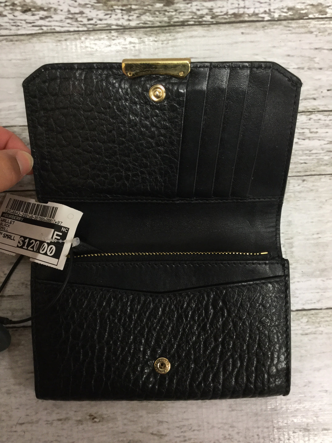 Photo #1 - <P>BRAND: BURBERRY , STYLE: WALLET , COLOR: BLACK , SIZE: SMALL , SKU: 127-4942-2331</P> <P>THIS BURBERRY WALLET IS VERY GENTLY USED AND IN GREAT CONDITION. IT HAS SEVERAL CARD SLOTS AND SPACE FOR BOTH CHANGE AND CASH. </P>
