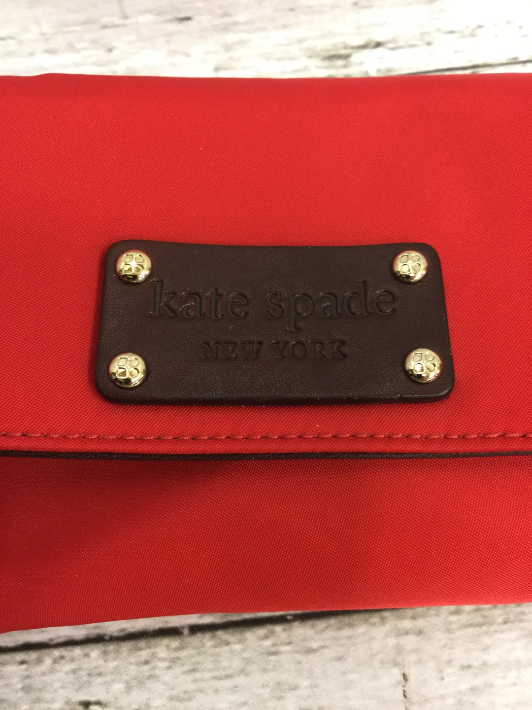 Photo #1 - BRAND: KATE SPADE , STYLE: WALLET , COLOR: RED , SIZE: SMALL , SKU: 127-3371-48386, , IN GREAT CONDITION. MINOR WEAR ON THE INSIDE LEATHER (AS PICTURED).