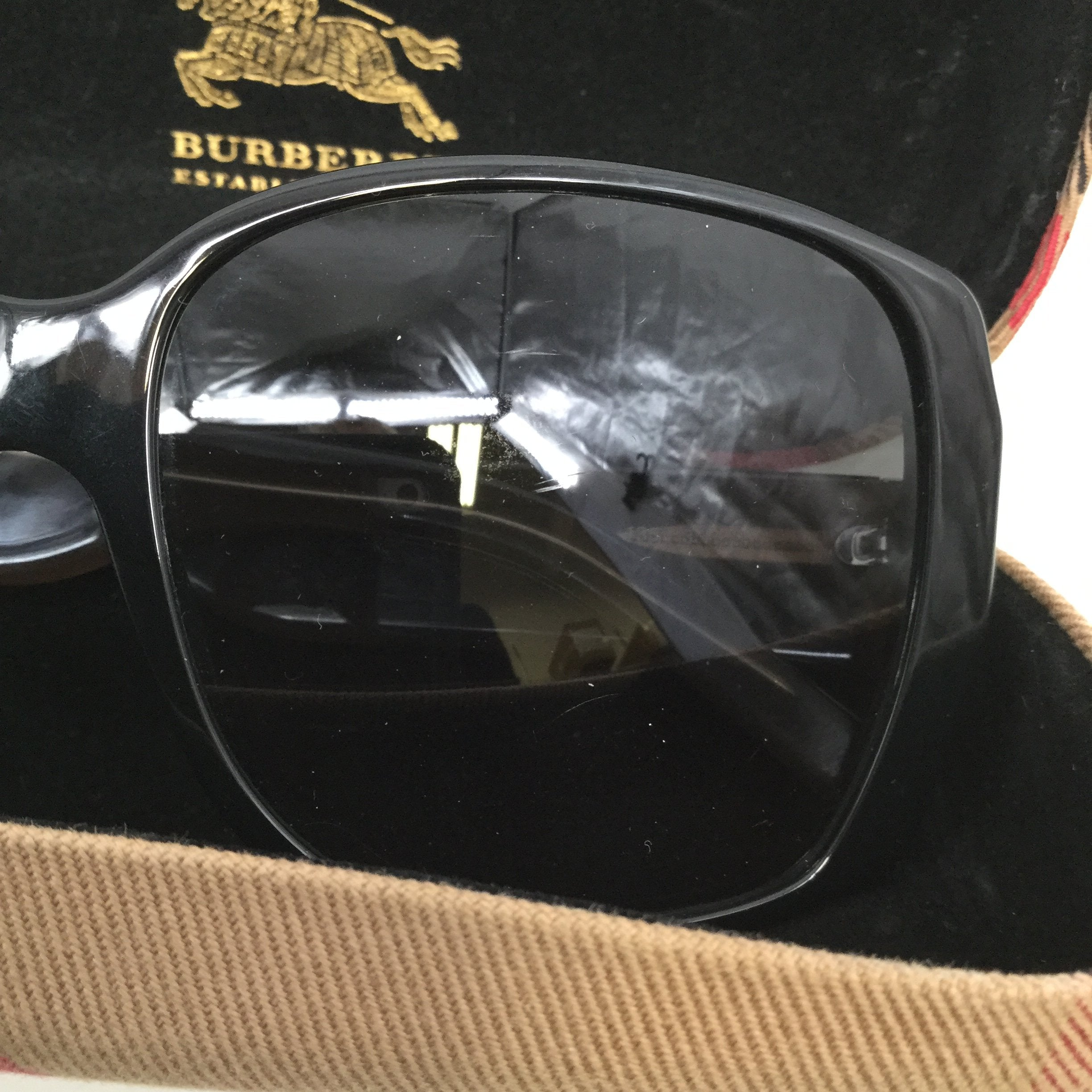 BURBERRY SUNGLASSES - <P>BLACK FRAMES WITH BROWN AND BLACK SIDES. STYLE B-4105M. SIZE 58-16-135. A FEW SCRATCHES CAN BE SEEN ON THE OUTSIDE OF THE LENSES BUT NOT FROM THE INSIDE.</P>