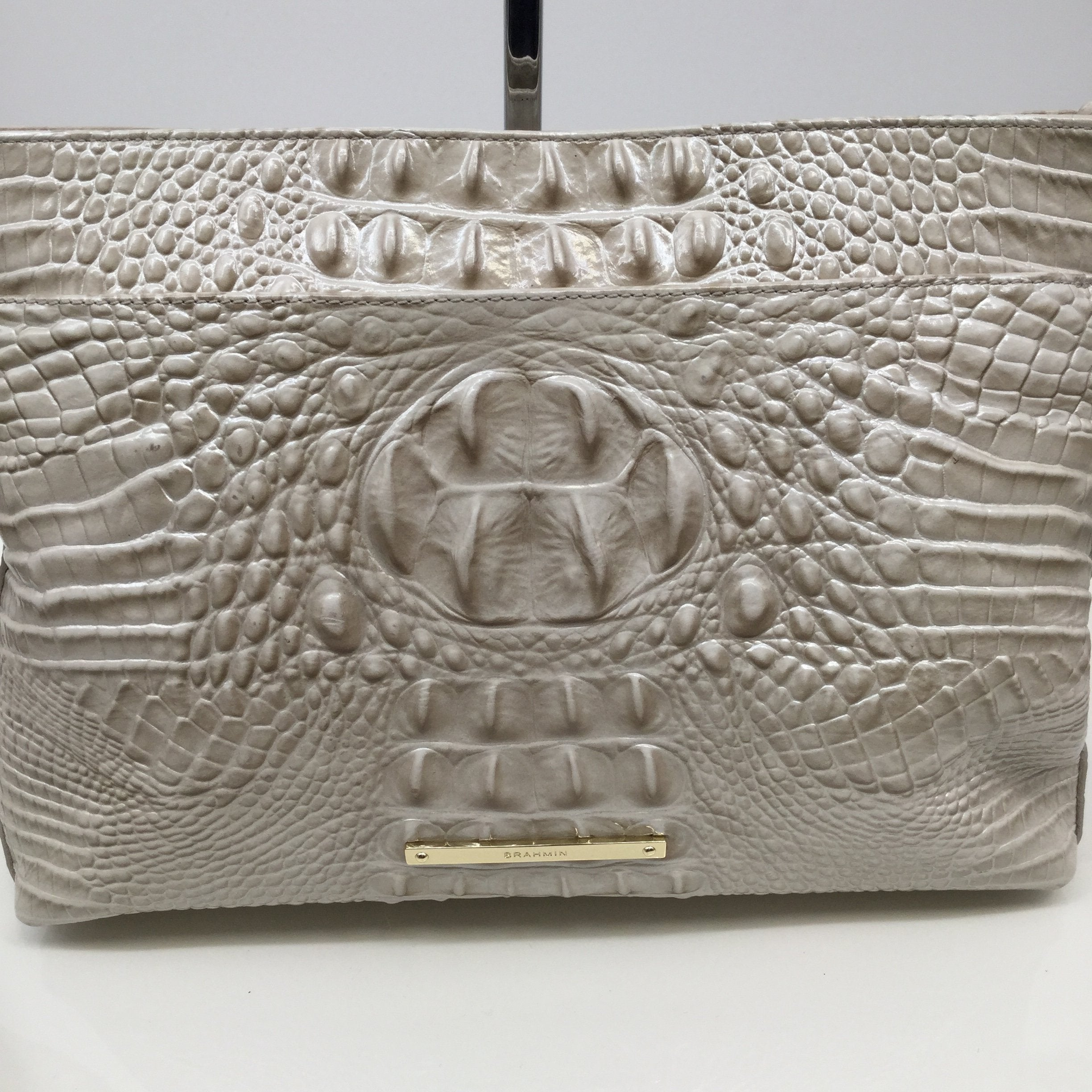 Brahmin Cream Crocodile Print Designer Handbag  - <P>KEEP IT COOL WITH THIS CREAM COLORED CROCODILE PRINTED DESIGNER HANDBAG BY BRAHMIN. LIKE NEW CONDITION INSIDE AND OUT. MARK ON THE OUTSIDE OF THE BAG THAT IS PICTURED, DOES BLEND WITH THE BAG. MEASURES 9 INCHES HIGH AND 12 INCHES WIDE. HAVE THIS DESIGNER HANDBAG FOR ONLY $95.</P>