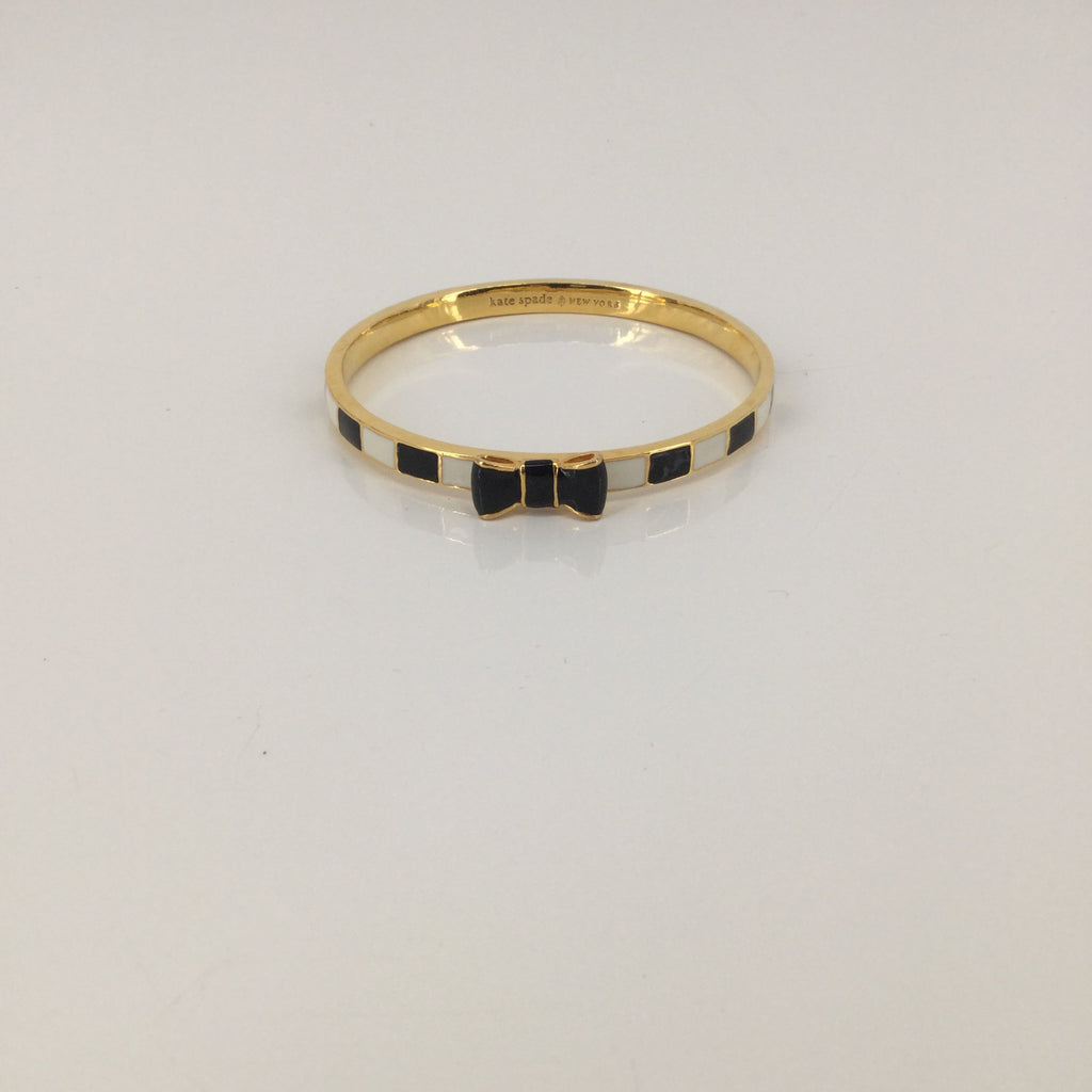 Kate Spade Gold, White, and Black Bracelet