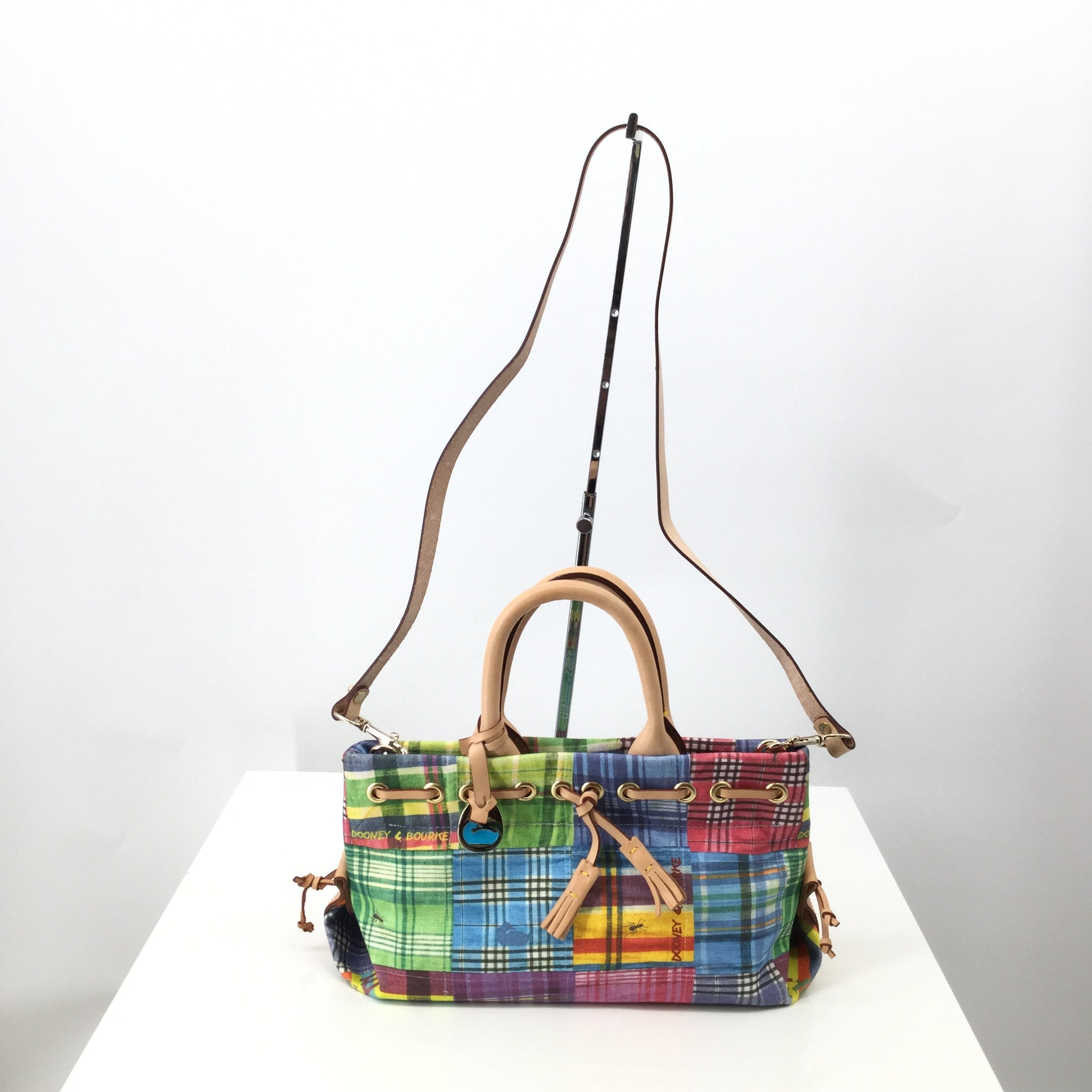 Dooney And Bourke O Handbag Designer Size:small - <P>SMALL PLAID MULTI-COLORED DOONEY AND BOURKE BAG WITH REMOVABLE LONG STRAP. TAN LEATHER ACCENTS AND A SNAP CLOSURE.</P>