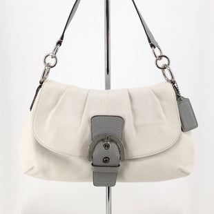 Medium Sized White and Gray Coach Handbag  - MEDIUM SIZED WHITE AND GRAY LEATHER COACH HANDBAG WITH SILVER DETAILING. SNAP CLOSURE AND POCKET ON THE BACK OF THE HANDBAG. CREAM INTERIOR WITH ONE LARGE POCKET, ONE ZIPPERED POCKET, AND TWO SMALLER POCKETS. LIKE NEW CONDITION..