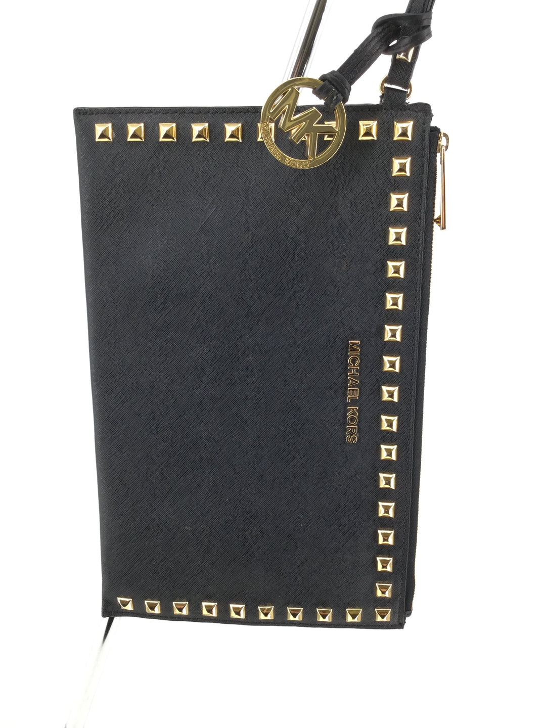 Black Leather Michael Kors Medium Size Clutch  - <P>MEDIUM SIZED BLACK LEATHER MICHAEL KORS CLUTCH WITH GOLD STUDS AROUND THE BOARDER. BLACK INTERIOR WITH ONE SMALL POCKET AND SIX CARD SLOTS. GENTLY USED CONDITION.</P>