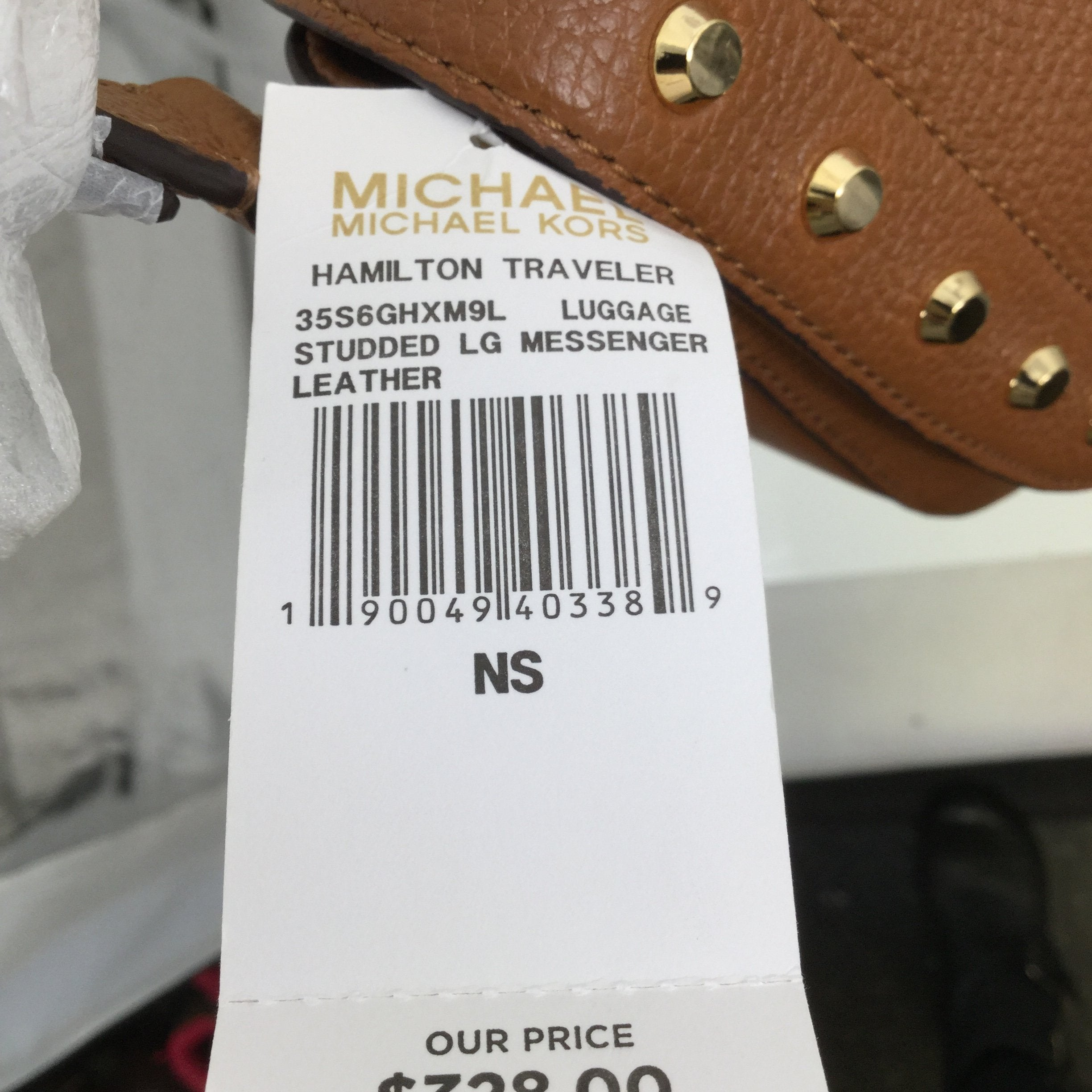 MICHAEL BY MICHAEL KORS HANDBAG SIZE:MEDIUM - <P>NEW WITH TAGS AND PACKING STILL ON STRAP. CARAMEL COLOR WITH GOLD STUDS. APPROX. 10.5