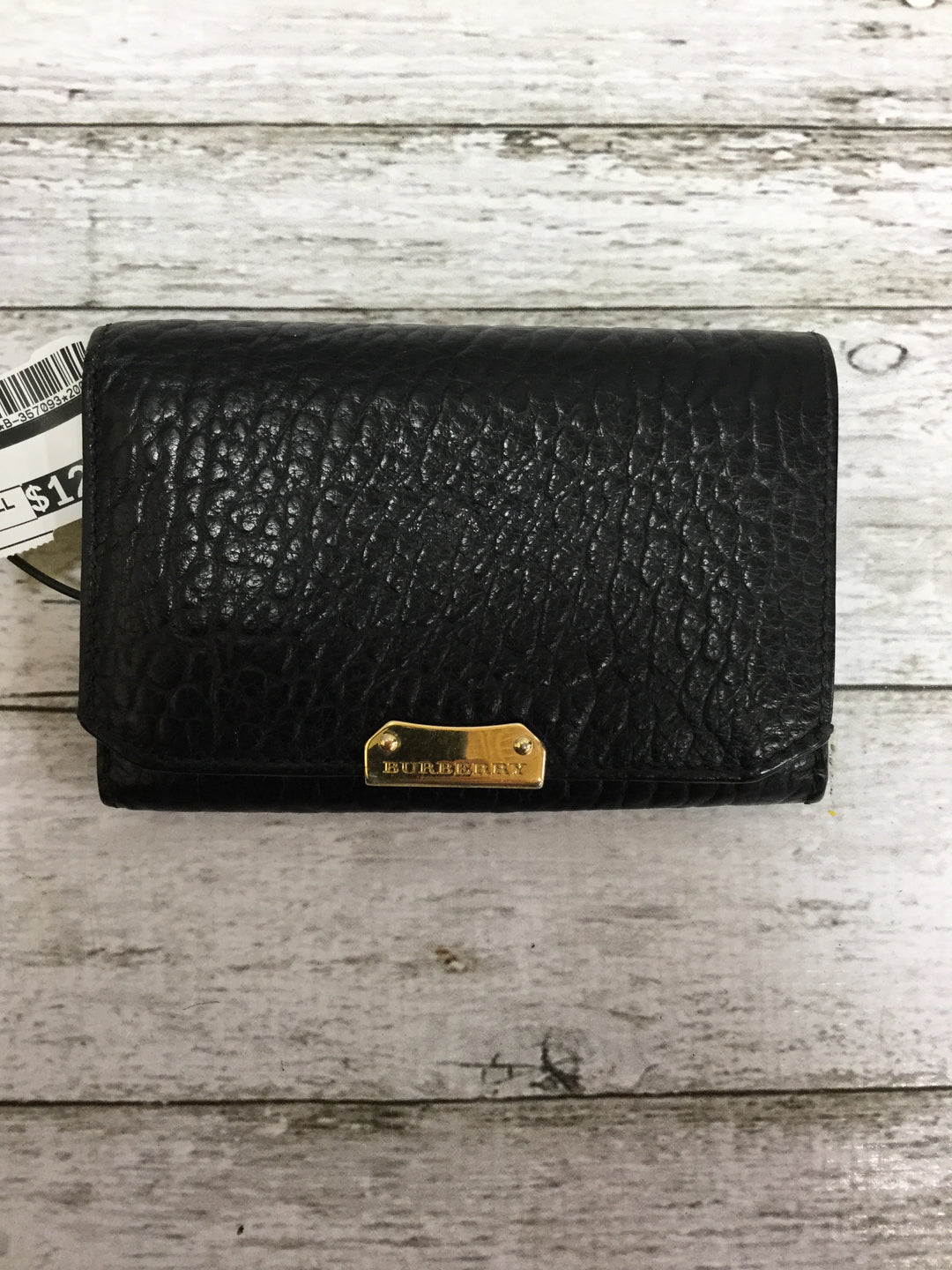 Primary Photo - <P>BRAND: BURBERRY , STYLE: WALLET , COLOR: BLACK , SIZE: SMALL , SKU: 127-4942-2331</P> <P>THIS BURBERRY WALLET IS VERY GENTLY USED AND IN GREAT CONDITION. IT HAS SEVERAL CARD SLOTS AND SPACE FOR BOTH CHANGE AND CASH. </P>