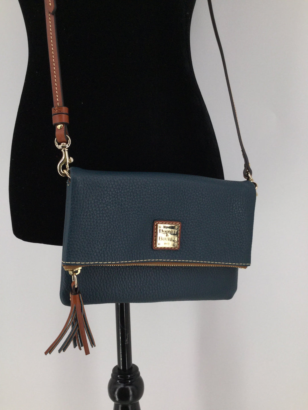 Dooney And Bourke Designer Handbag, Leather, Teal, Size:small - <P>VERY GENTLY USED DOONEY AND BOURKE HANDBAG. IN GREAT CONDITION. CLOSES WITH A ZIPPER AND MAGNETS. TEAL WITH BROWN DETAILS.</P>