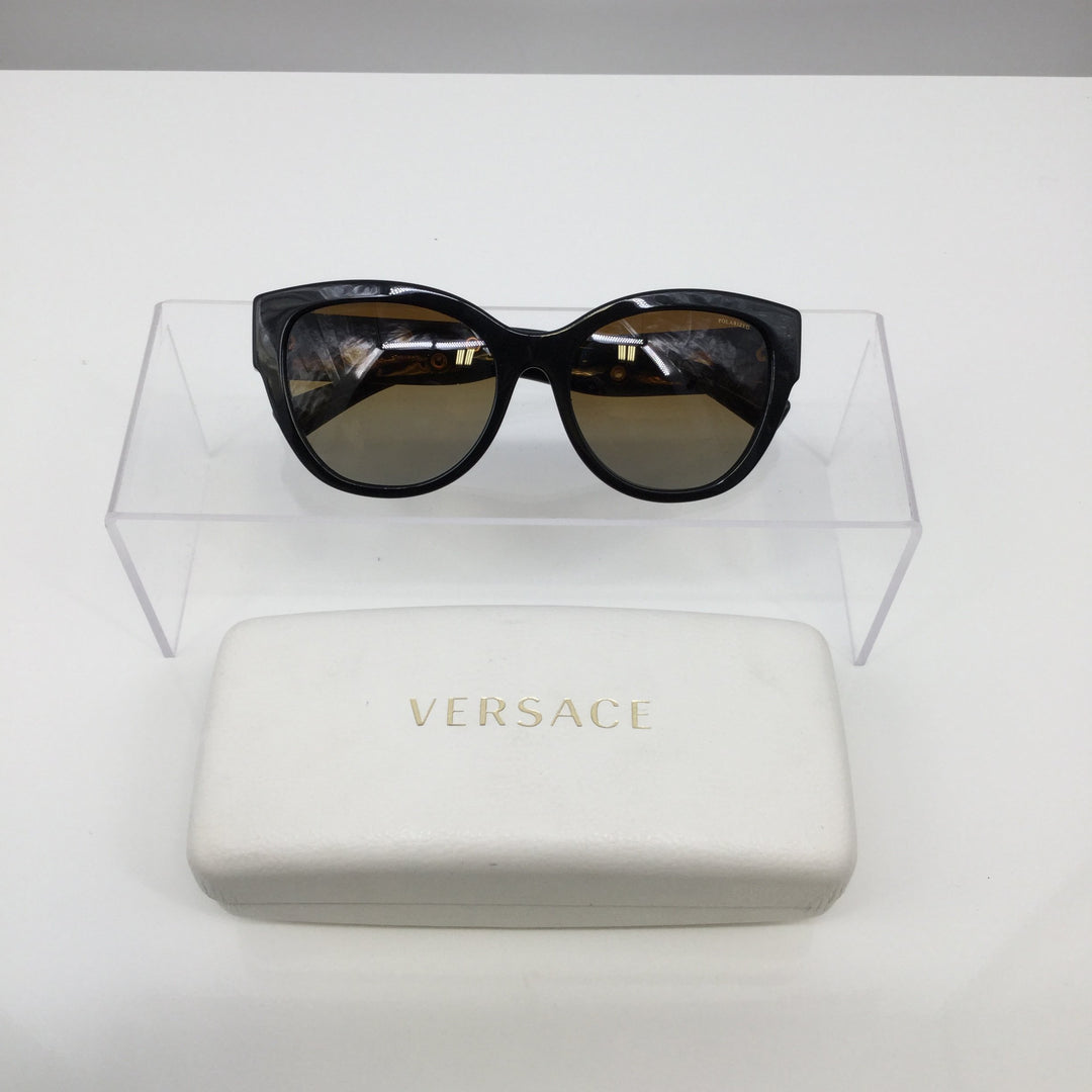 VERSACE SUNGLASSES - <P>EXCELLENT CONDITION. GRADIENT BROWN. BLACK FRAMES. SIZE 56-18-140. MODEL 4314. GOLD CIRCLE EMBELLISHMENTS ON SIDEARMS.</P>