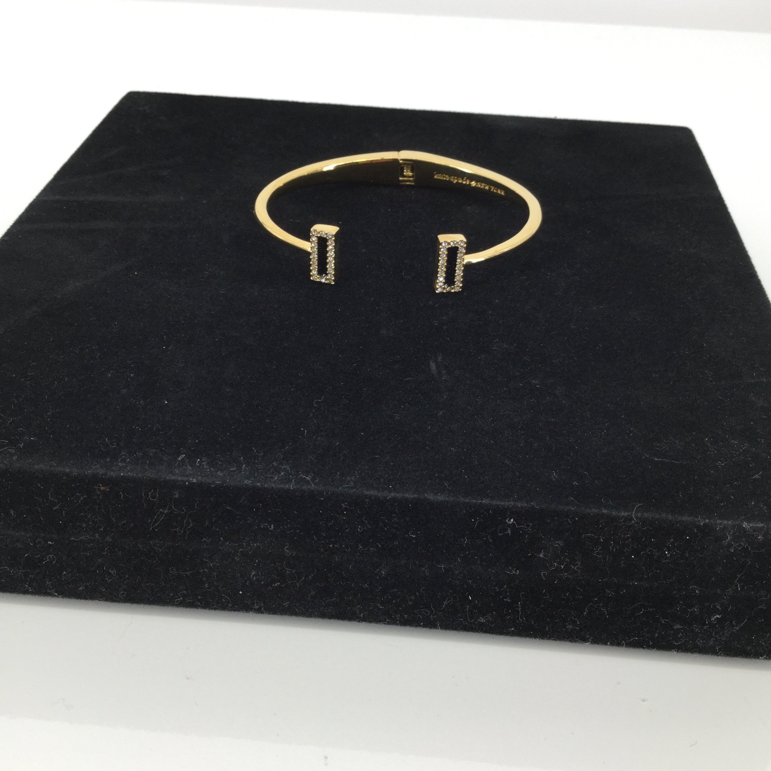 Kate Spade Bracelet - <P>CHIC KATE SPADE BANGLE BRACELET. SEMICIRCLE SHAPE.  BLACK RECTANGLE DETAIL WITH DIAMOND TRIM.  SOME MINOR SIGNS OF WEAR.  SEE PHOTOS.,  IN EXCELLENT PRE-OWNED CONDITION.</P>