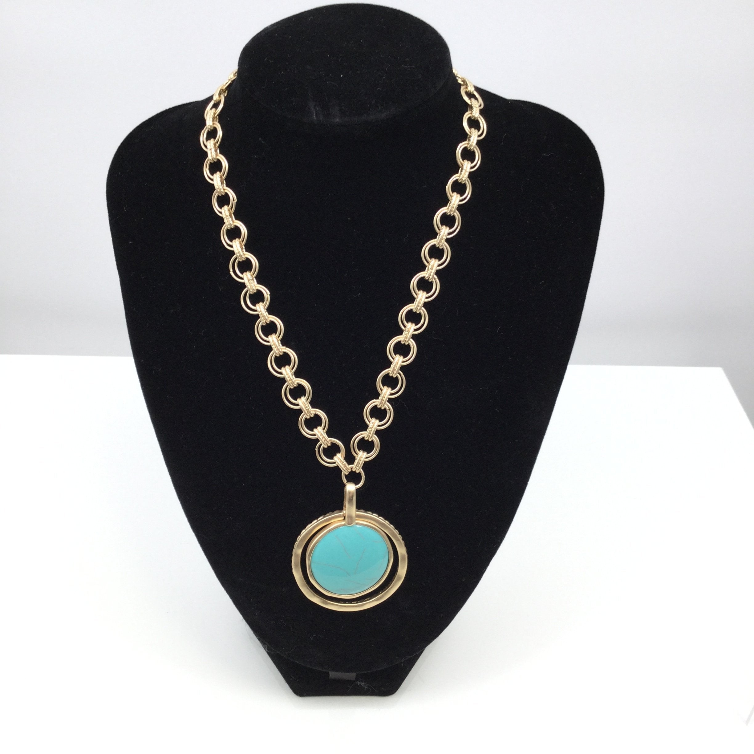 CHICOS TURQUOISE AND COIN NECKLACE - <P>TWO NECKLACES IN 1!,  ONE SIDE IS A TURQUOISE DISC AND THE OTHER A ROMAN COIN.,  GOLD HARDWARE.</P>