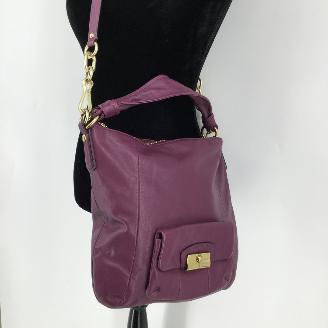 Purple Coach Designer Handbag - <P>THIS BEAUTIFUL PLUM COLORED COACH INCLUDES A SMALL POCKET ON THE FRONT, A SHOULDER STRAP AND A REMOVABLE CROSSBODY STRAP! INSIDE THERE ARE SEVERAL SLIP POCKETS AND A ZIPPER POCKET. THIS BAG IS IN VERY GOOD CONDITION WITH LITTLE TO NO WEAR.</P>