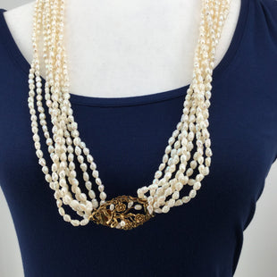 CMD Freshwater Pearl Necklace With Gold Broach Clasp - STUNNING FRESHWATER PEARL NECKLACE. 8 PEARL STRANDS CONNECTED TO A GOLD FLOWERED BROACH CLASP.  FLORAL CLASP CONTAINS PEARL ACCENTS. BEAUTIFUL DESIGN. EXCELLENT CONDITION..