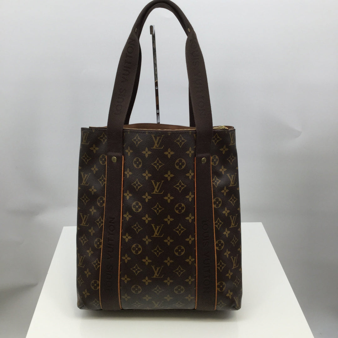 LOUIS VUITTON CABAS TOTE BAG, SIZE LARGE - <P>AUTHENTIC LOUIS VUITTON CABAS TOTE BAG WITH CANVAS HANDLES. BROWN. EXCELLENT CONDITION! SELLS ON EBAY FOR $800 WITH CORNER WEAR. 13