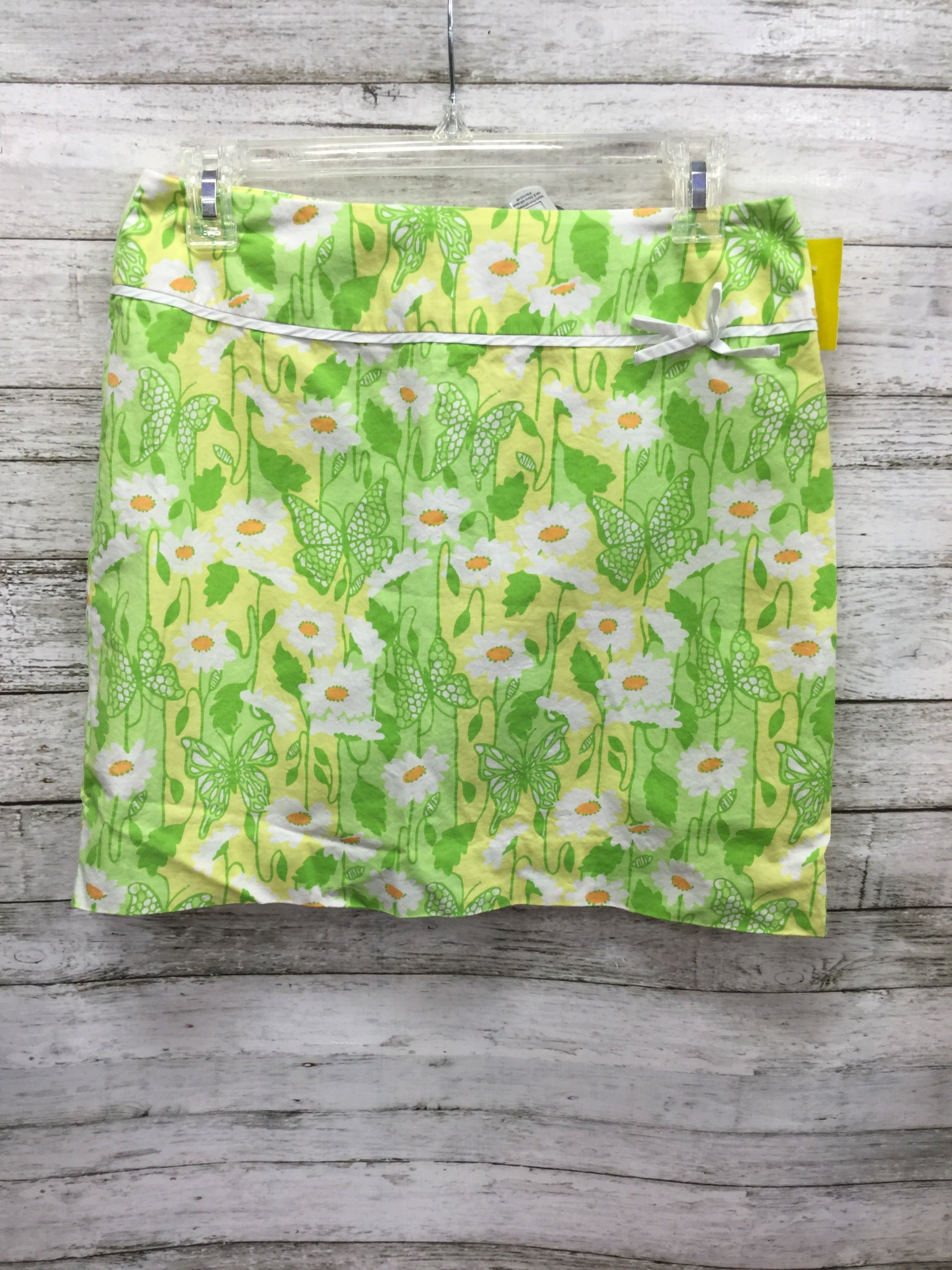 Primary Photo - BRAND: LILLY PULITZER , STYLE: SKIRT , COLOR: GREEN , SIZE: 2 , SKU: 127-3371-45721, , LILLY PULITZER SKIRT IN THE CUTEST PASTEL GREEN, YELLOW, ORANGE AND WHITE PRINT WITH FLOWERS AND BUTTERFLIES! FEATURES WHITE TRIM AND BOW DETAIL.