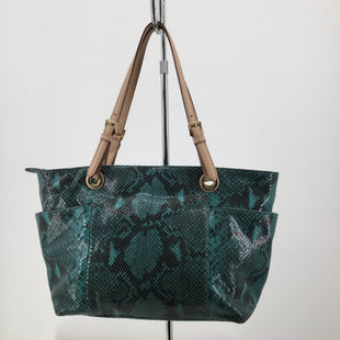 Green Animal Print Michael Kors Designer Handbag   - THE PRINT OF THIS MICHAEL KORS BAG IS SO STYLISH! IT IS GREEN ANIMAL PRINT WITH TAN LEATHER STRAPS. IT COMES WITH SOME MINOR WEAR ON THE OUTSIDE (SEE PHOTOS. THE INSIDE IS VERY CLEAN!.