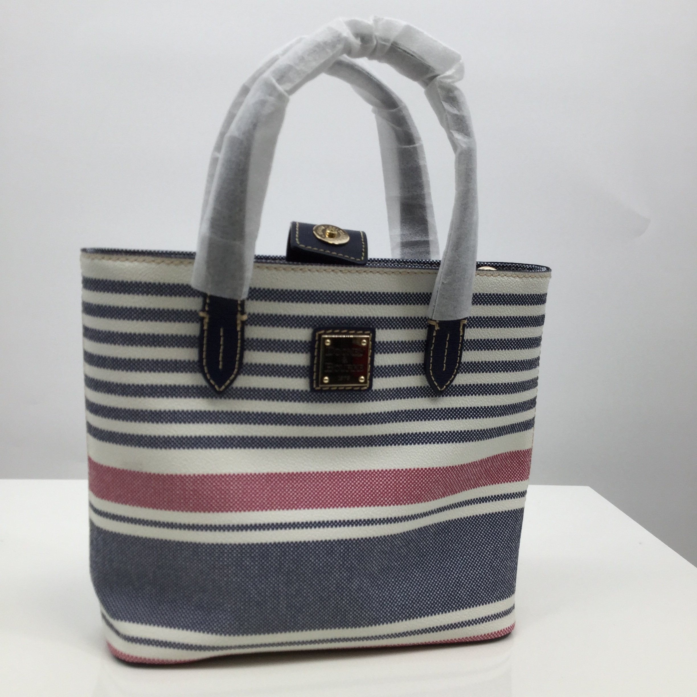 Dooney And Bourke Handbag, Leather, Blue, White, And Red, Small - <P>THIS CUTE DOONEY AND BOURKE LEATHER HANDBAG IS A GREAT BAG FOR ANY SEASON. IT IS BRAND NEW WITH TAGS STILL ATTACHED! IT IS IN PERFECT CONDITION.</P>