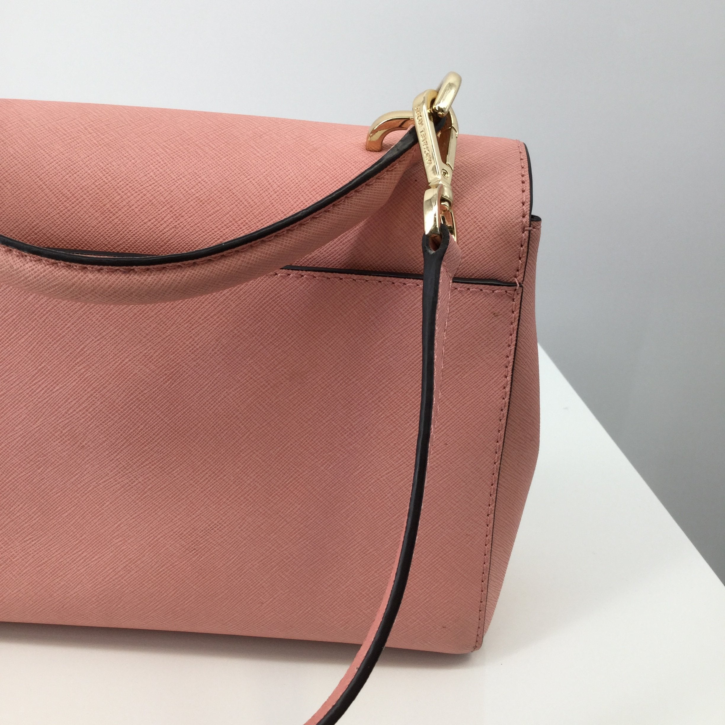 Michael Kors Handbag Designer, Leather, Pink, Size: Medium - <P>THIS PINK MICHAEL KORS HANDBAG IS SO CUTE! IT IS LEATHER WITH GOLD DETAILS. THERE IS A POCKET ON THE BACK AND TWO POCKETS INSIDE. THE STRAP IS ADJUSTABLE. CONDITION IS GOOD. DUST BAG INCLUDED.</P>