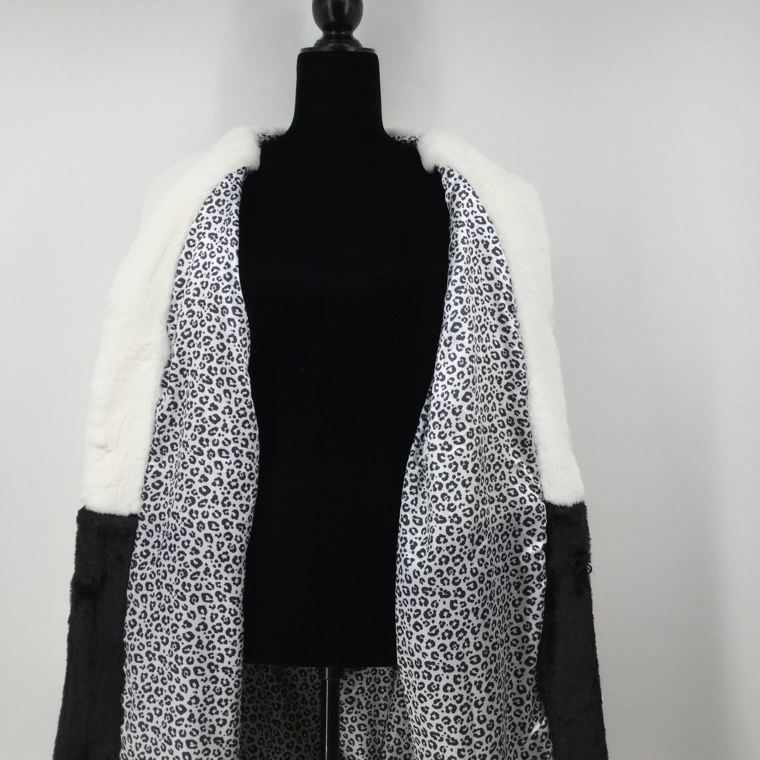 Fever Long Coat, Faux Fur, Black And Off White, Size XL - <P>THIS FEVER COAT IS FAUX FUR ON THE OUTSIDE WITH A LEOPARD PRINT ON THE INSIDE. THERE ARE FOUR BUTTONS DOWN THE FRONT. IT IS IN PERFECT CONDITION WITH THE ORIGINAL TAGS STILL ATTACHED.</P>