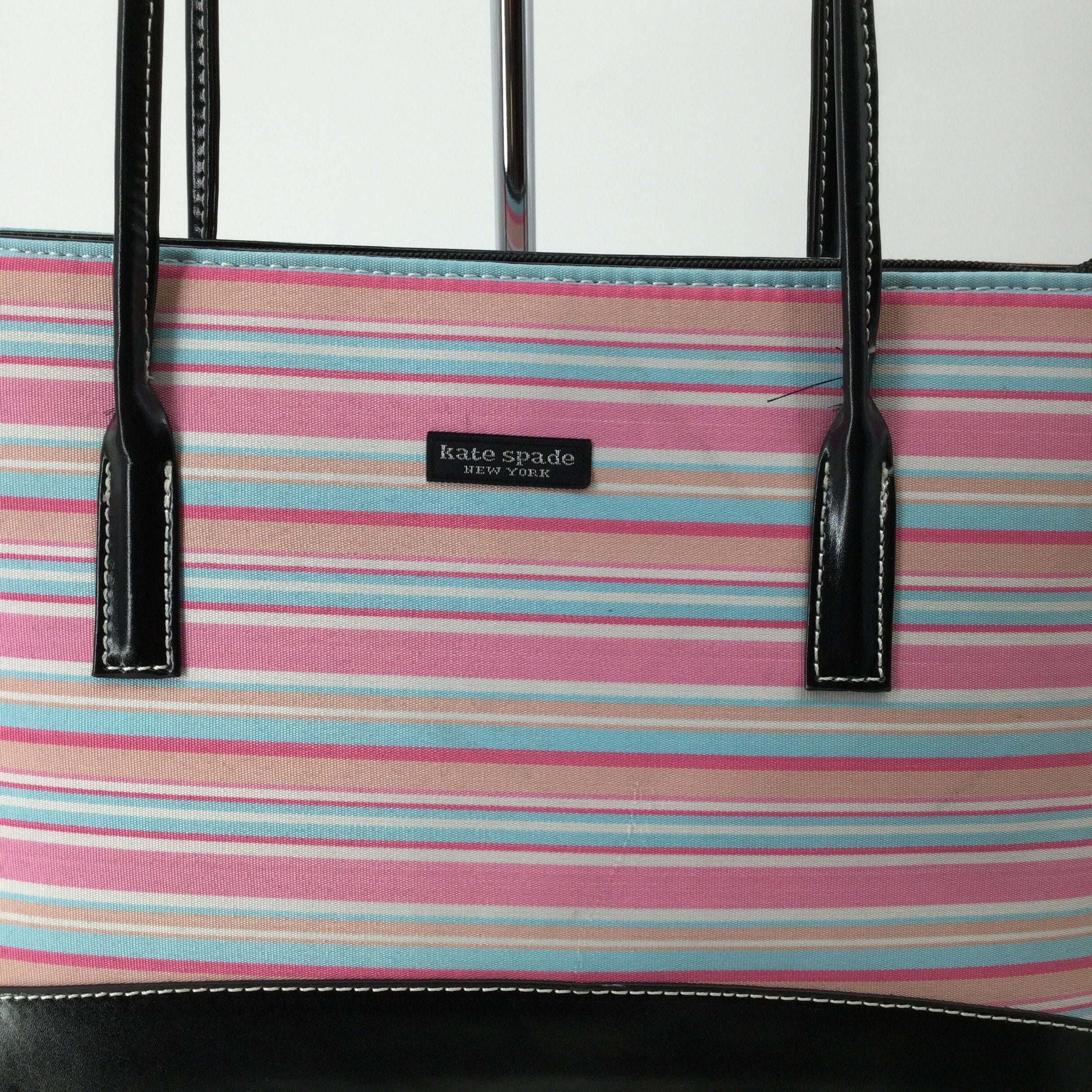 Kate Spade Designer Handbag, Pink, Blue, Orange, White, Size: Medium - <P>THIS COLORFUL KATE SPADE HANDBAG HAS A FABRIC BODY WITH A LEATHER BOTTOM AND LEATHER STRAPS. THERE ARE PLENTY OF POUCHES AND ZIPPERED POCKETS INSIDE FOR STORAGE. IT HAS SOME MINOR WEAR ON THE EXTERIOR FABRIC (SEE PHOTOS).</P>