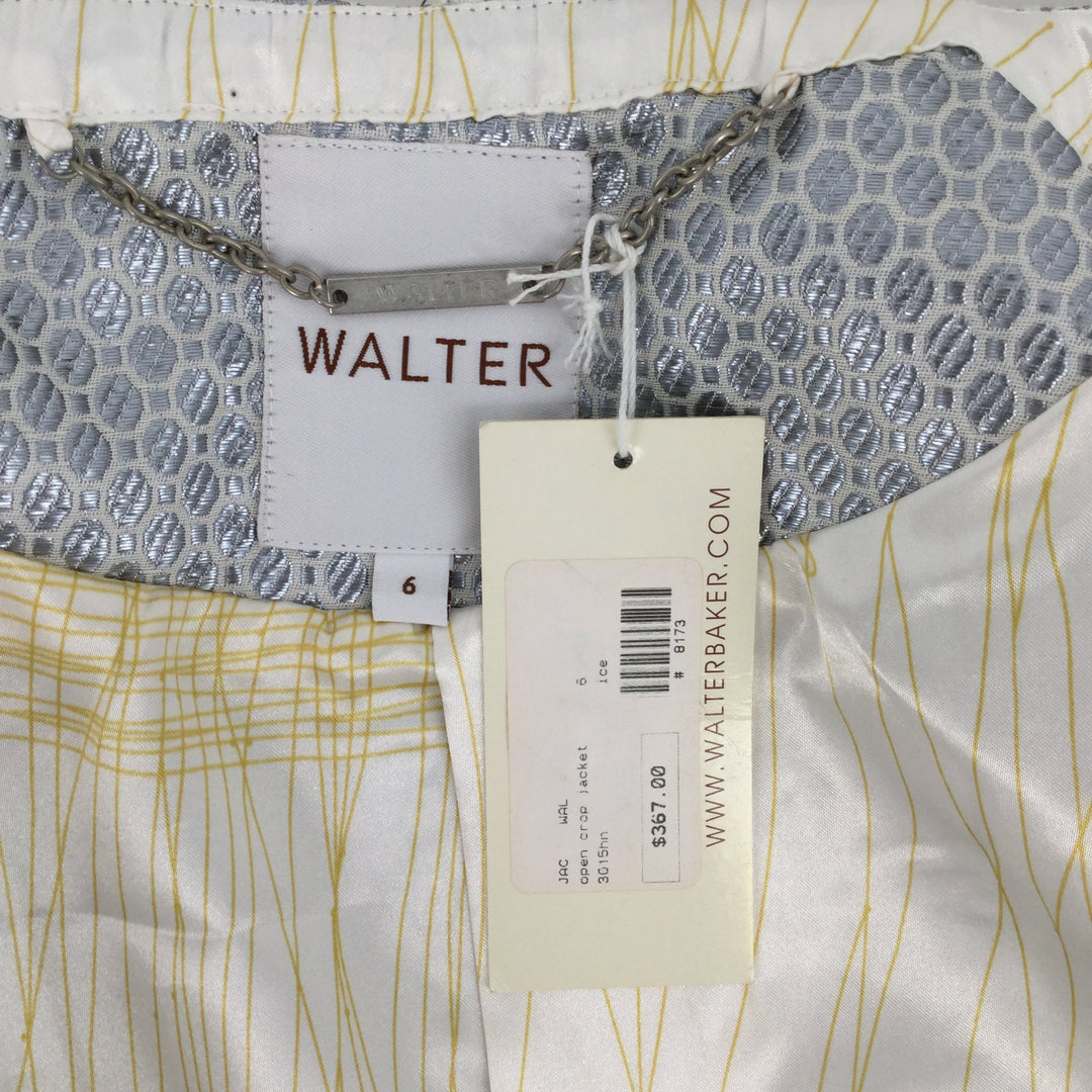 Walter Baker Blazer Jacket, Silver, Size: 6 - <P>THIS WALTER BAKER BLAZER IS IN GOOD CONDITION WITH THE ORIGINAL TAG STILL ATTACHED. IT IS OFF WHITE WITH A SILVER OVAL AND SQUARE PATTERN. THE BLAZER IS ABOUT WAIST LENGTH HAS ELBOW LENGTH SLEEVES.</P>