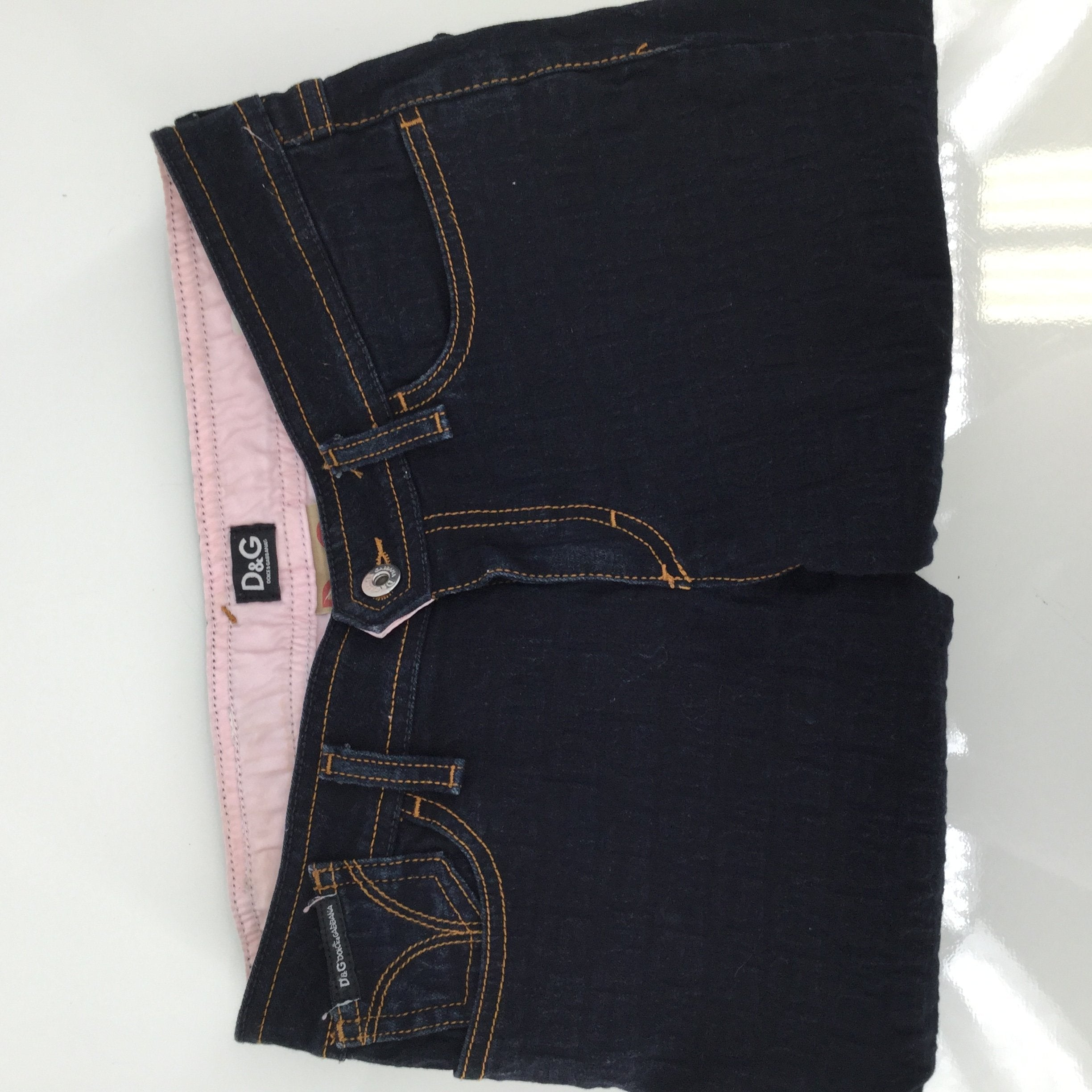 "Dolce And Gabbana Jeans, Denim, Blue, Size: 2 - THESE DOLCE AND GABBANA SKINNY JEANS HAVE A 26 INCH WAIST. THEY ARE A DARK BLUE WASH WITH A SUBTLE ""D&G"" PRINT. THERE ARE ZIPPERS AT THE BOTTOM OF EACH PANT LEG. THEY ARE IN VERY GOOD CONDITION AND DO NOT LOOK LIKE THEY HAVE BEEN WORN MUCH."