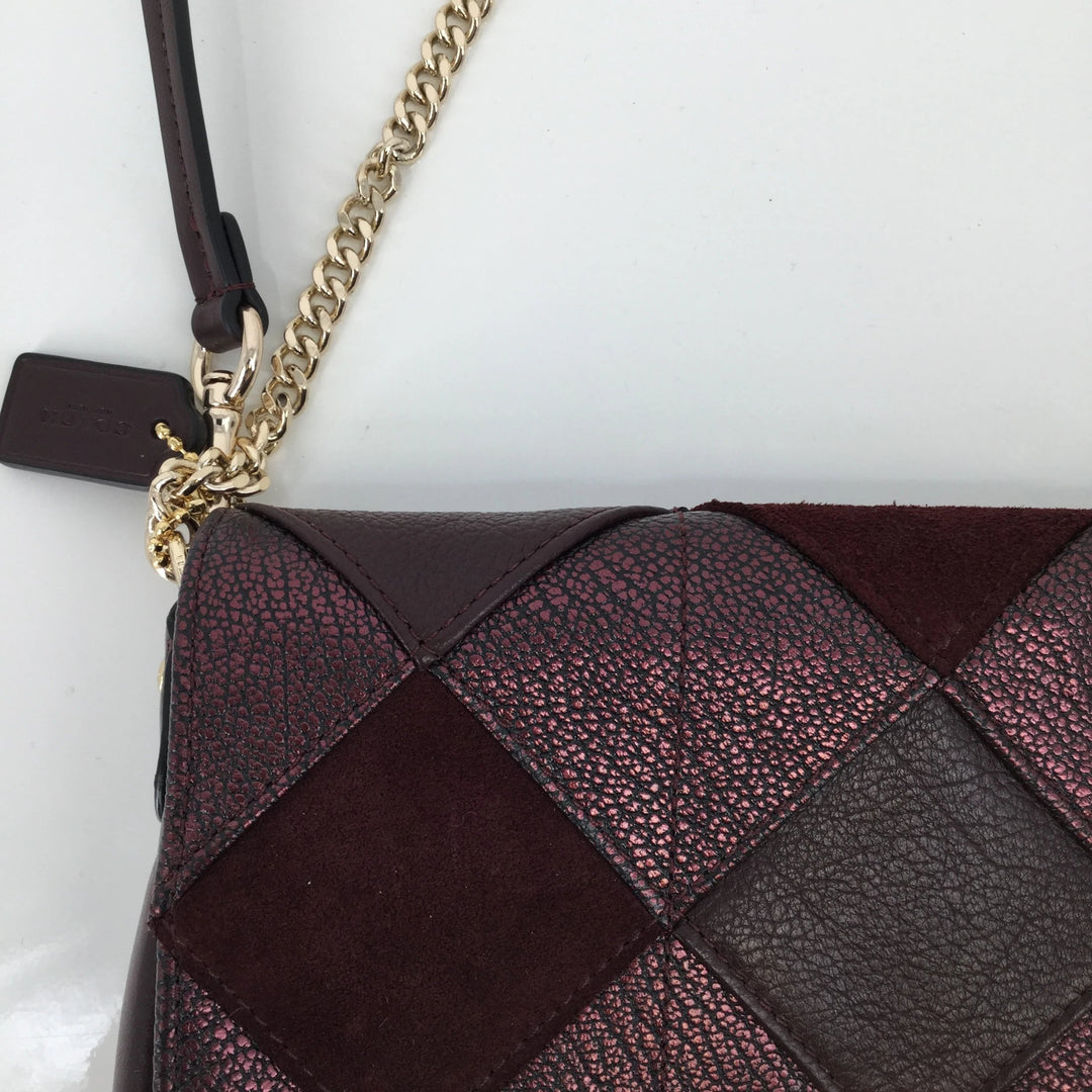 Coach Designer Handbag, Leather, Burgundy, Size: Small - <P>THIS COACH CROSSBODY FEATURES A GOLD CHAIN AND A SQUARE PATTERN ON THE FRONT. IT IS IN VERY GOOD CONDITION WITH JUST SOME MINOR WEAR ON THE BACK (SEE PHOTOS).</P>