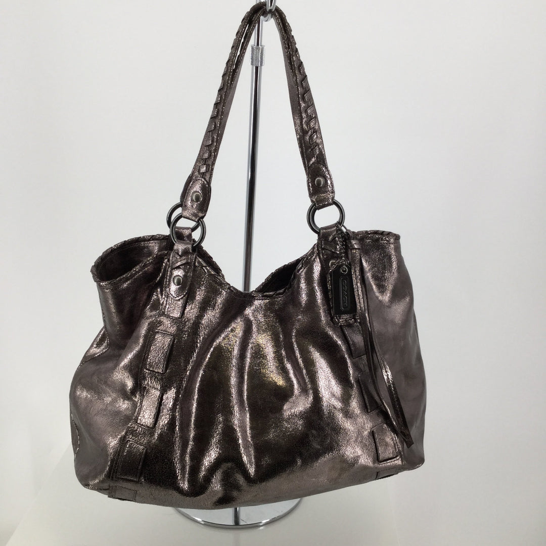 Coach Metallic Handbag Designer Size Large - <P>BEAUTIFUL COACH METALLIC HANDBAG! COMES WITH SLEEPER BAG.  THREE-COMPARTMENT HANDBAG, ZIPPER COMPARTMENTS ON INSIDE, WITH A SNAP ENCLOSURE AT THE TOP. CHARCOAL HARDWARE. MINOR SIGNS OF WEAR. SEE PHOTOS PLEASE. IN GREAT PRE-OWNED CONDITION.</P>